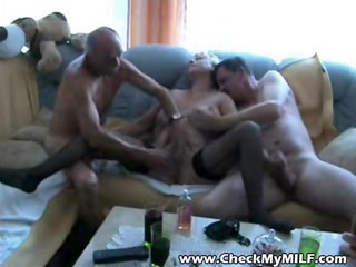 old granny milf engulfing cocks at group-sex party