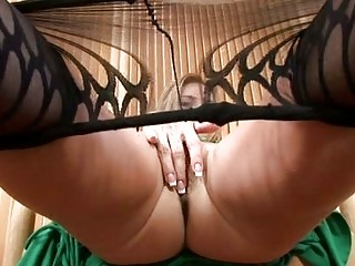 sexy milf in pantyhose disrobes and masturbates