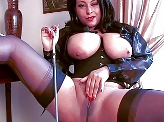 arousing dark brown momma in corset and stockings