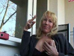 sexy aged hottie smoking on patio