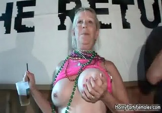 excited mature golden-haired woman sharing her