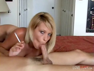 blond milf smokes and gives a hot blowjob, face