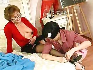 juvenile gal kisses and licks mature woman