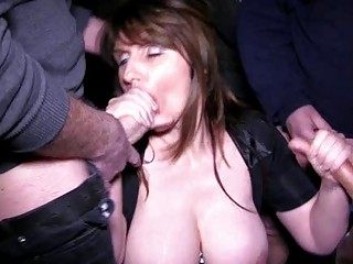 busty brunette milf acquires into a bukkake