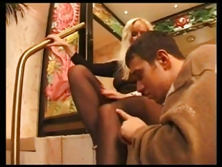 sexy milf gives a footjob with black hose