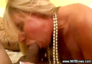 sweet blonde cougar is sucking a cock