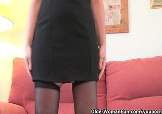classy grandma in stockings shows her large tits