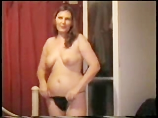 mature wife filmed taking a baths