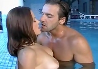 busty natural milf finds a friend at the pool