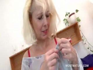 sexy aged playgirl strips to masturbate pussy