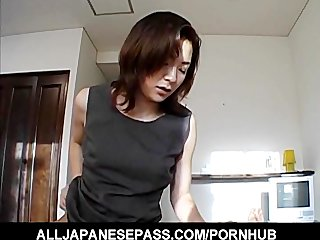 japanese milf in an office costume sucks a big