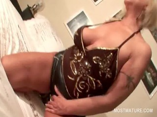 slutty aged in latex suit riding a vibrator in
