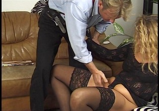 blonde gives husband pedicure